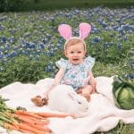 Photo of girl with bunny in flowers
