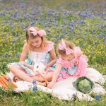 Photo of girls with bunny in flowers