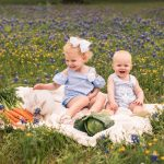 Photo of brother and sister with bunny in flowers
