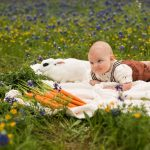 Photo of baby with bunny in flowers