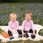 Photo of boys with bunny in flowers
