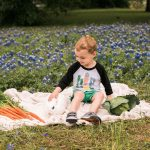 Photo of boy with bunny in flowers